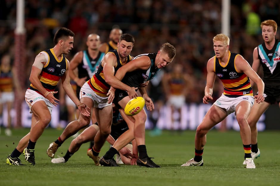 ADELAIDE, AUSTRALIA - MAY 11: Rory Atkins of the Crows tackles Dan Houston of the Power during the 2019 AFL round 08 match between the Port Adelaide Power and the Adelaide Crows at Adelaide Oval on May 11, 2019 in Adelaide, Australia. (Photo by James Elsby/AFL Photos)