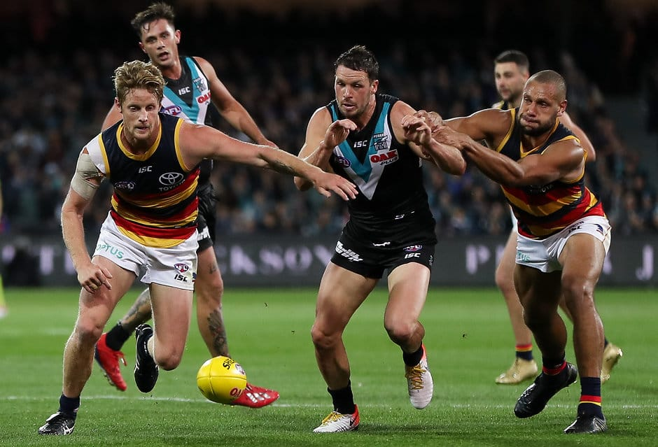 ADELAIDE, AUSTRALIA - MAY 11: Rory Sloane and Cameron Ellis-Yolmen of the Crows compete for the ball with Travis Boak of the Power during the 2019 AFL round 08 match between the Port Adelaide Power and the Adelaide Crows at Adelaide Oval on May 11, 2019 in Adelaide, Australia. (Photo by Matt Turner/AFL Photos)