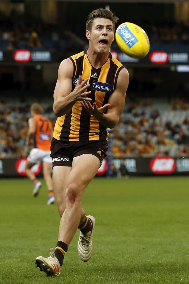 MELBOURNE, AUSTRALIA - MAY 12: James Cousins of the Hawks marks the ball during the 2019 AFL round 08 match between the Hawthorn Hawks and the GWS Giants at the Melbourne Cricket Ground on May 12, 2019 in Melbourne, Australia. (Photo by Dylan Burns/AFL Photos)