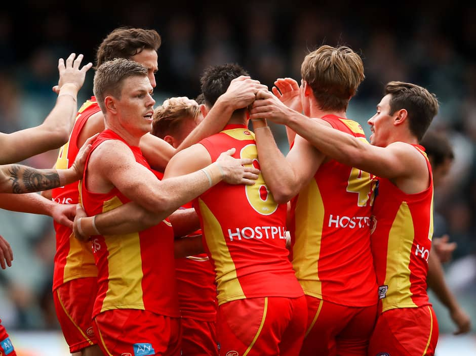 ADELAIDE, AUSTRALIA - MAY 19: Brayden Fiorini of the Suns celebrates a goal with team mates during the 2019 AFL round 09 match between the Port Adelaide Power and the Gold Coast Suns at Adelaide Oval on May 19, 2019 in Adelaide, Australia. (Photo by Matt Turner/AFL Photos)