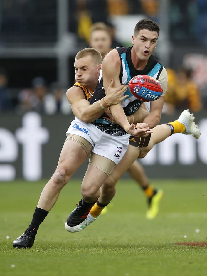LAUNCESTON, AUSTRALIA - MAY 25: Tom Rockliff of the Power is tackled by James Worpel of the Hawks during the 2019 AFL round 10 match between the Hawthorn Hawks and the Port Adelaide Power at UTAS Stadium on May 25, 2019 in Launceston, Australia. (Photo by Dylan Burns/AFL Photos)