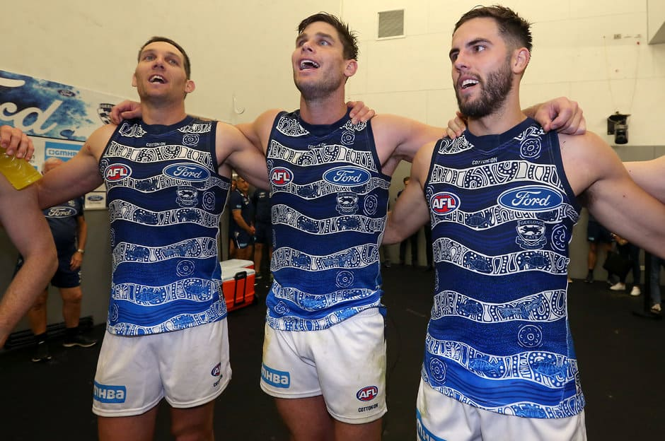 Harry Taylor, Tom Hawkins and James Parsons celebrate the win in the rooms. - Geelong Cats,Tim Kelly,Tom Hawkins