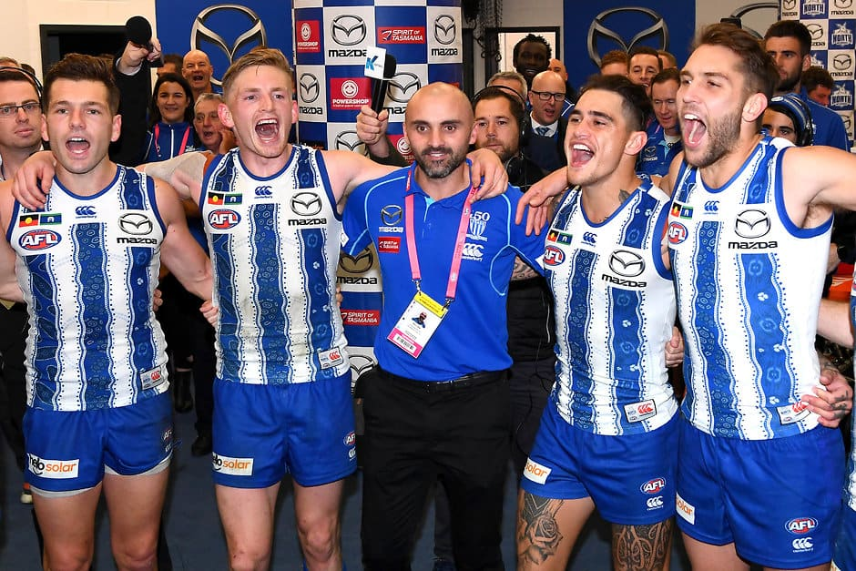Rhyce Shaw enjoys his debut win with the North Melbourne players after the game - AFL,North Melbourne Kangaroos,Rhyce Shaw,Tag-Analysis