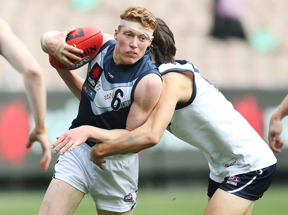 MELBOURNE, AUSTRALIA - JUNE 01: Matthew ROWELL of Vic Metro runs with the ball during the U18s match between Vic Metro and Vic Country at Melbourne Cricket Ground on June 01, 2019 in Melbourne, Australia. (Photo by Michael Dodge/Getty Images)