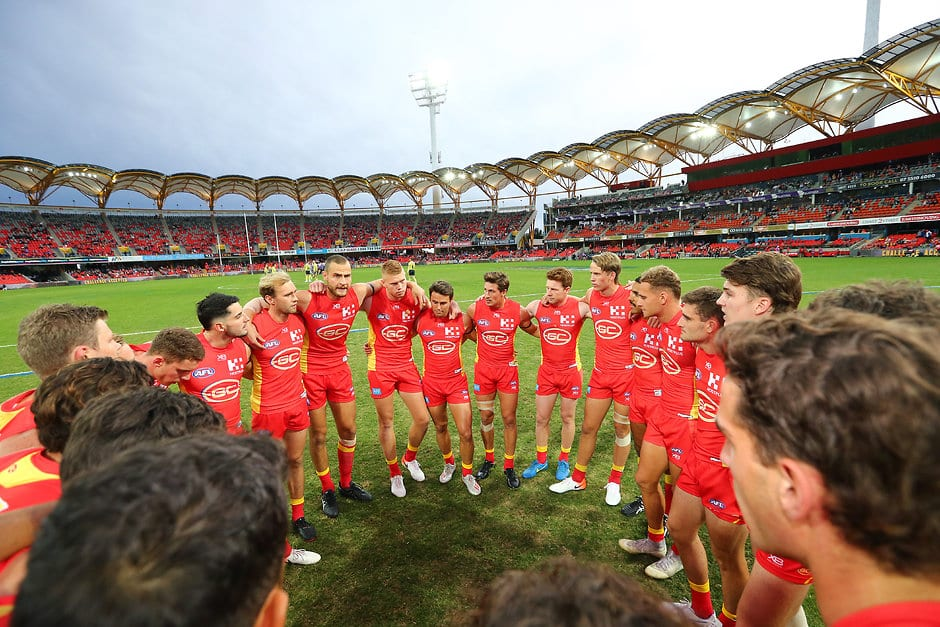 GOLD COAST, AUSTRALIA - JUNE 08: The Suns get in a huddle before the round 12 AFL match between the Gold Coast Suns and the North Melbourne Kangaroos at Metricon Stadium on June 08, 2019 in Gold Coast, Australia. (Photo by Jono Searle/AFL Photos/Getty Images)