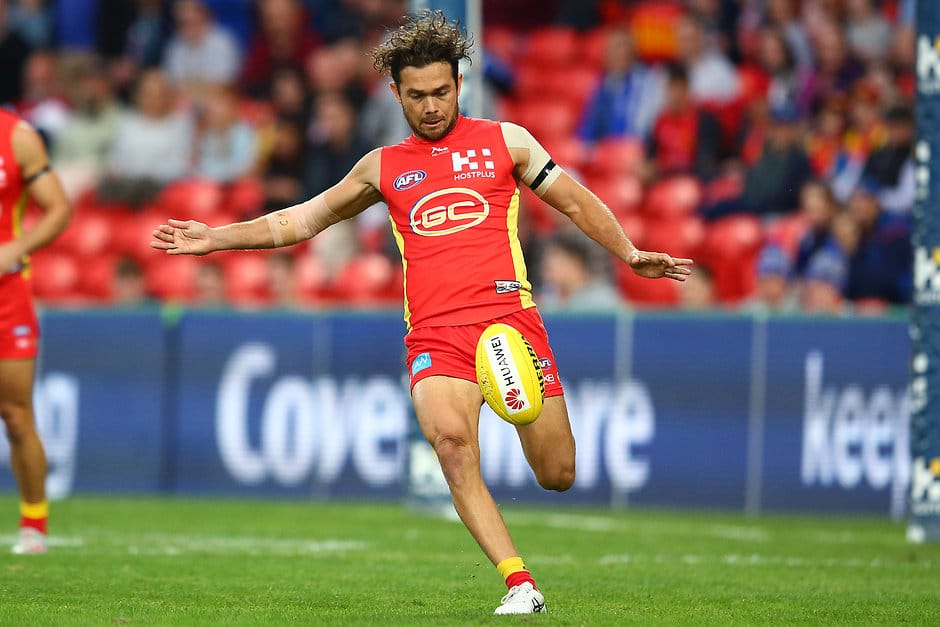 GOLD COAST, AUSTRALIA - JUNE 08: Jarrod Harbrow of the Suns kicks the ball during the round 12 AFL match between the Gold Coast Suns and the North Melbourne Kangaroos at Metricon Stadium on June 08, 2019 in Gold Coast, Australia. (Photo by Jono Searle/AFL Photos/Getty Images)
