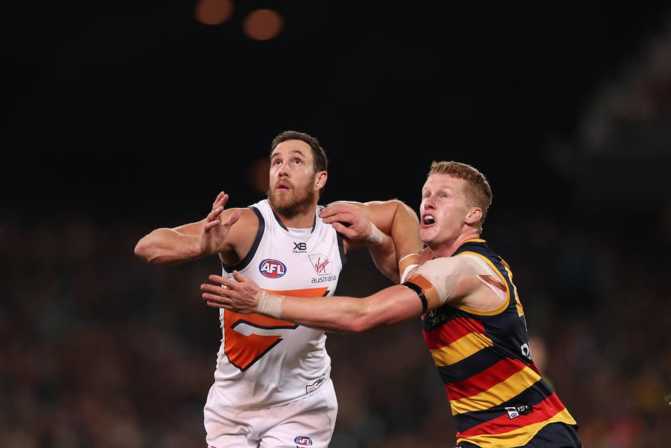 ADELAIDE, AUSTRALIA - JUNE 08: Shane Mumford of the Giants competes with Reilly O'Brien of the Crows during the 2019 AFL round 12 match between the Adelaide Crows and the GWS Giants at the Adelaide Oval on June 08, 2019 in Adelaide, Australia. (Photo by James Elsby/AFL Photos)