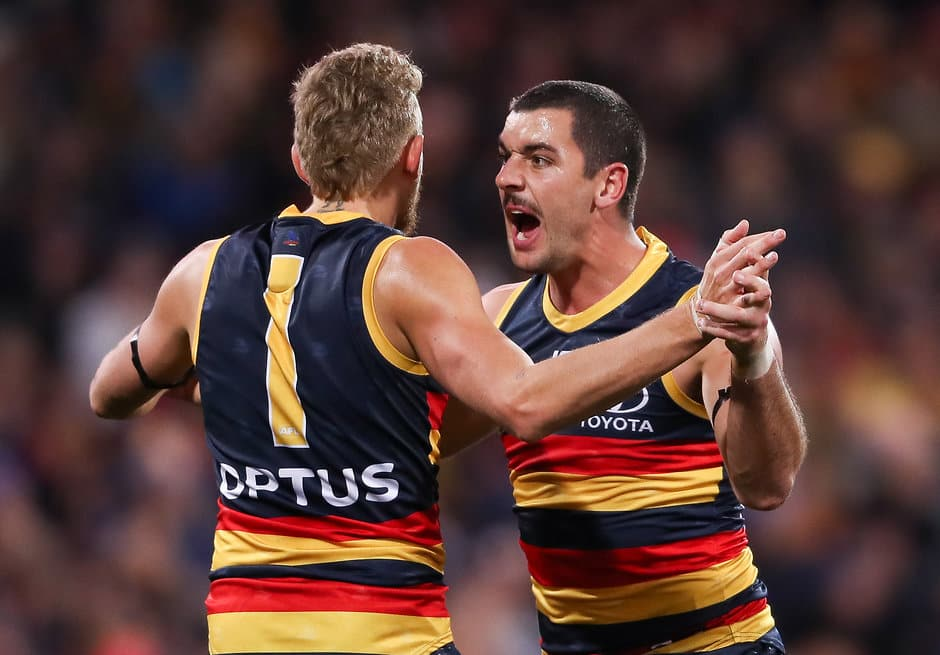 ADELAIDE, AUSTRALIA - JUNE 08: Taylor Walker of the Crows celebrates a goal with team mate Hugh Greenwood during the 2019 AFL round 12 match between the Adelaide Crows and the GWS Giants at the Adelaide Oval on June 08, 2019 in Adelaide, Australia. (Photo by Matt Turner/AFL Photos)