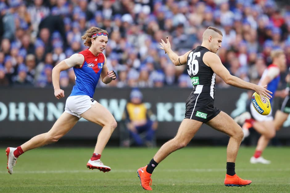 MELBOURNE, AUSTRALIA - JUNE 10: Brayden Sier of Collingwood kicks the ball during the 2019 AFL round 12 match between the Collingwood Magpies and the Melbourne Demons at the Melbourne Cricket Ground on June 10, 2019 in Melbourne, Australia. (Photo by Michael Dodge/AFL Photos)