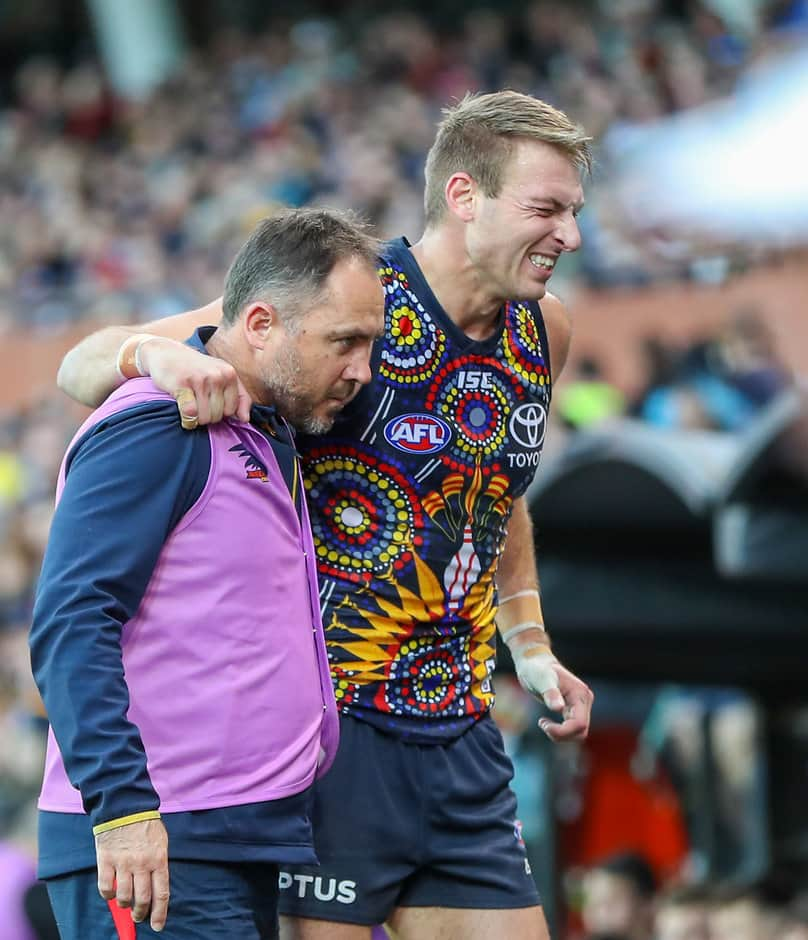 ADELAIDE, AUSTRALIA - JULY 06: Daniel Talia of the Crows leaves the field injured during the 2019 AFL round 16 match between the Adelaide Crows and the Port Adelaide Power at the Adelaide Oval on July 06, 2019 in Adelaide, Australia. (Photo by Matt Turner/AFL Photos)