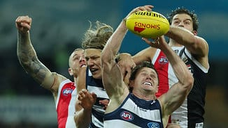 Cats shake off spirited Saints to maintain gap at the top