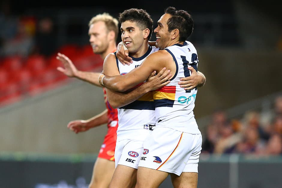 GOLD COAST, AUSTRALIA - JULY 13: Tyson Stengle of the Crows celebrates his goal with team mate Eddie Betts during the round 17 AFL match between the Gold Coast Suns and the Adelaide Crows at Metricon Stadium on July 13, 2019 in Gold Coast, Australia. (Photo by Jono Searle/AFL Photos)