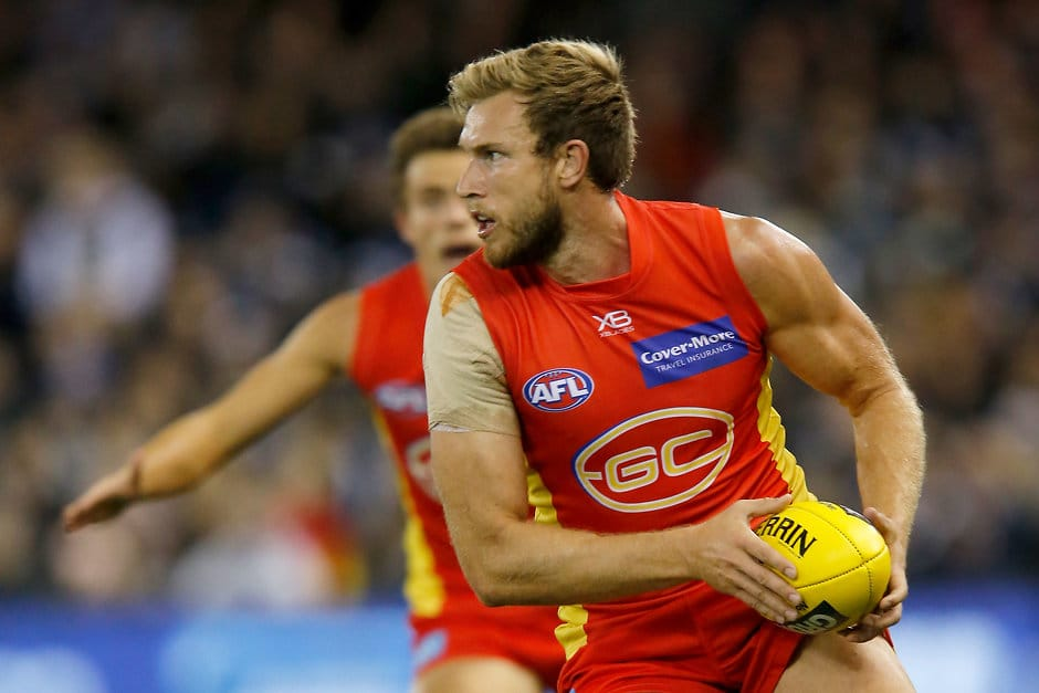 MELBOURNE, AUSTRALIA - JULY 20: Sam Day of the Suns runs with the ball during the 2019 AFL round 18 match between the Carlton Blues and the Gold Coast Suns at Marvel Stadium on July 20, 2019 in Melbourne, Australia. (Photo by Darrian Traynor/AFL Photos)