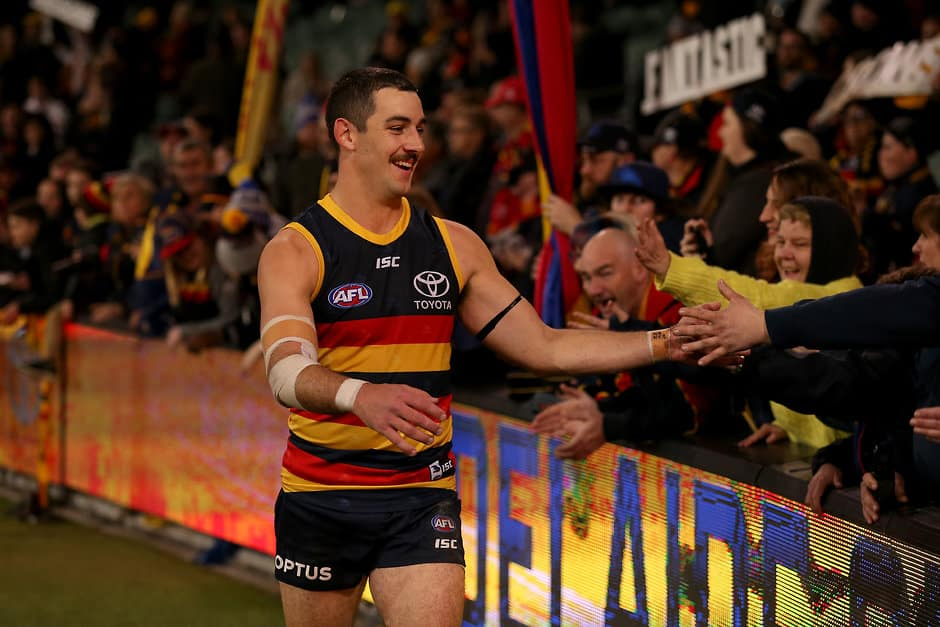 ADELAIDE, AUSTRALIA - AUGUST 03: Taylor Walker of the Crows celebrates their win during the 2019 AFL round 20 match between the Adelaide Crows and the St Kilda Saints at the Adelaide Oval on August 03, 2019 in Adelaide, Australia. (Photo by James Elsby/AFL Photos)