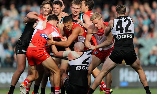 ADELAIDE, AUSTRALIA - AUGUST 10: A small melee erupts after Riley Bonner of the Power marked the ball then got hit by Ryan Clarke of the Swans during the 2019 AFL round 21 match between the Port Adelaide Power and the Sydney Swans at Adelaide Oval on August 10, 2019 in Adelaide, Australia. (Photo by Matt Turner/AFL Photos)