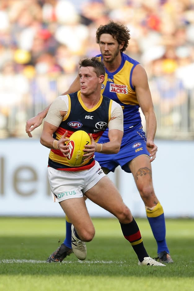 PERTH, AUSTRALIA - AUGUST 11: Matt Crouch of the Crows looks to pass the ball during the 2019 AFL round 21 match between the West Coast Eagles and the Adelaide Crows at Optus Stadium on August 11, 2019 in Perth, Australia. (Photo by Will Russell/AFL Photos)