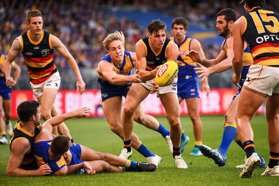 PERTH, AUSTRALIA - AUGUST 11: Jake Kelly of the Crows handpasses the ball during the 2019 AFL round 21 match between the West Coast Eagles and the Adelaide Crows at Optus Stadium on August 11, 2019 in Perth, Australia. (Photo by Daniel Carson/AFL Photos)