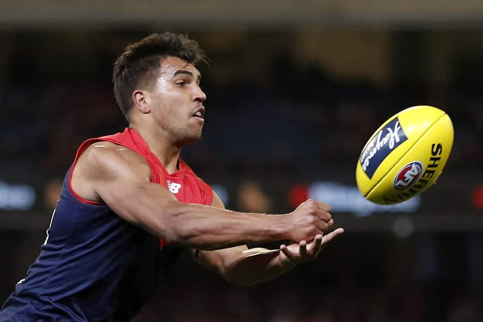 MELBOURNE, AUSTRALIA - AUGUST 16: Jay Kennedy Harris of the Demons handpasses the ball during the 2019 AFL round 22 match between the Melbourne Demons and the Sydney Swans at the Melbourne Cricket Ground on August 16, 2019 in Melbourne, Australia. (Photo by Dylan Burns/AFL Photos)
