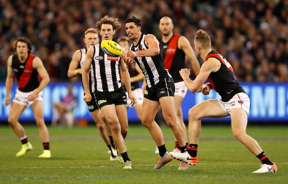 Scott Pendlebury gets a handball away during the Pies' win over the Bombers - Collingwood Magpies,Essendon Bombers