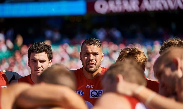 SYDNEY, AUSTRALIA - AUGUST 24: Lance Franklin of the Swans looks on during a team huddle during the round 23 AFL match between the Sydney Swans and the St Kilda Saints at Sydney Cricket Ground on August 24, 2019 in Sydney, Australia. (Photo by Brett Hemmings/AFL Photos)