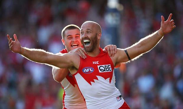 SYDNEY, AUSTRALIA - AUGUST 24: Jarrad McVeigh of the Swans celebrates kicking a goal with team mates Tom Papley of the Swans during the round 23 AFL match between the Sydney Swans and the St Kilda Saints at Sydney Cricket Ground on August 24, 2019 in Sydney, Australia. (Photo by Cameron Spencer/Getty Images via AFL Photos)