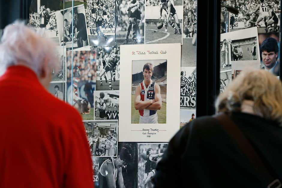MELBOURNE, AUSTRALIA - SEPTEMBER 10: Fans look at a tribute to Danny Frawley at St Kilda Saints Football Club on September 10, 2019 in Melbourne, Australia. Danny Frawley died yesterday aged 56 in a car accident at Ballarat. He was a former captain of the Saints and coached Richmond before embarking on a career in the media. (Photo by Darrian Traynor/Getty Images via AFL Photos)
