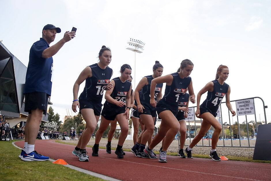 MELBOURNE, AUSTRALIA - OCTOBER 01: AFLW draft invitees begin their 2km time trial during the 2019 AFLW Draft Combine at the Holden Centre on October 01, 2019 in Melbourne, Australia. (Photo by Dylan Burns/AFL Photos)